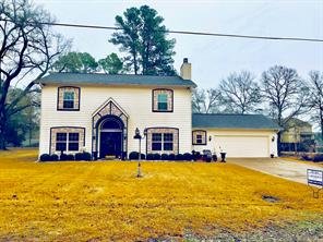 BEAUTIFUL HOME!   This home is absolutely amazing! The current owners had this home built and it is very custom. The home sits on a large lot in Woodland Acres. From the moment you pull in the drive, you will be impressed. The yard is beautifully landscaped. Open floor plan with nice kitchen, great cabinet space, island, and breakfast bar. The living has a fireplace and is perfect for entertaining. The spacious utility room has great storage and a full bath handy to the two-car garage. The master suite has a walk-in closet and dressing area, double sinks, and over-sized shower. The guest bedroom downstairs could be used as an office. Upstairs, there is a second living area, full bath and three spacious bedrooms. The back yard is an oasis with a large open patio, workshop and outdoor shower. If you enjoy fishing, you can launch your boat at Woodland Acres' park area. Call us today to see this home!