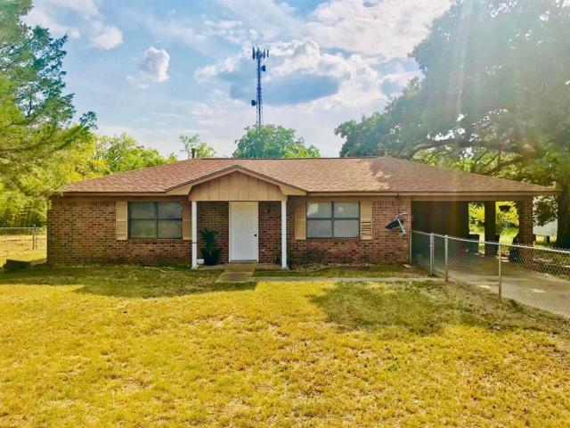 LOVELADY ISD!   This two bedroom, one bath brick home is priced to sell and ready for a new owner! The seller has recently put on a new roof and had interior of the home repainted. There is a nice kitchen with Formica counter-tops, gas stove, new refrigerator, and new microwave. The living and dining are open concept so there is room to gather. The laundry is spacious and has a handy utility sink. Two guest bedrooms are freshly painted and need floor coverings. There is a large bath with storage and walk-in shower with seat. Recent foundation work has warranty and will transfer to buyer at closing. Home has ceiling fans, alarm system, and central air and heat. Outdoors you will love the large yard that is fenced, nice carport, and storage building. Call today to view!