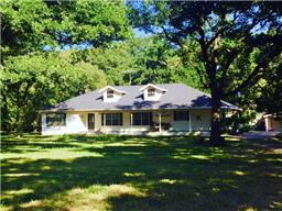 Welcome!  Come see this spacious 3/2 home on 2.179 acres - handy location - fronts on Hwy. 21W - close to town!  This home has lots of porch, a formal dining room, living room with wood burning fireplace, den with painted concrete floor or could be a game room,  and a handy kitchen and laundry with sink.  The master bedroom has its own private bath and all the bedrooms are carpeted.  Outdoors, you will enjoy the nice yard with pretty oak trees - come see!