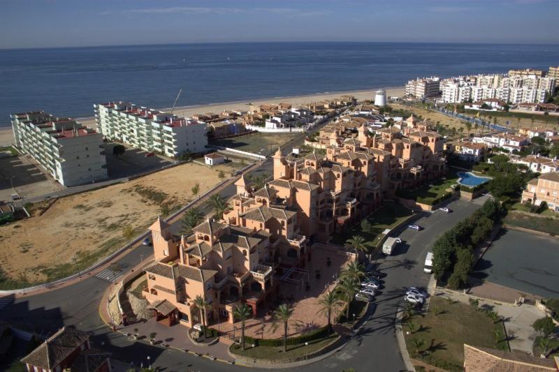 Haz tu reserva desde aquí, la web. APARTAMENTOS DUNAS DE DOÑANA GOLF RESORT Matalascañas - Huelva