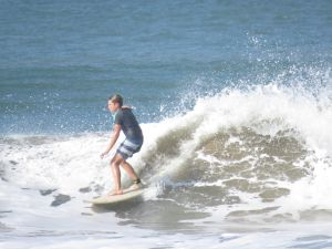 Young surfer riding a wave