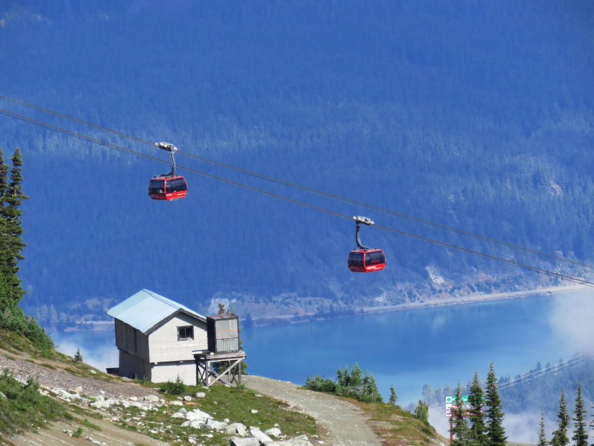 Two gondolas suspended in the air
