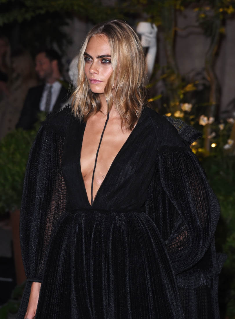 Cara Delevingne at Burberry show during London Fashion Week with black line painted down the