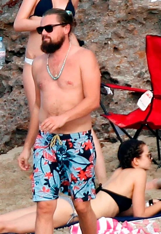 Leonardo DiCaprio surrounded by models in St Barts for the