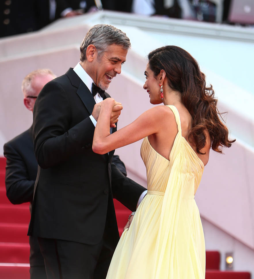 George and Amal Clooney with Julia Roberts at Cannes