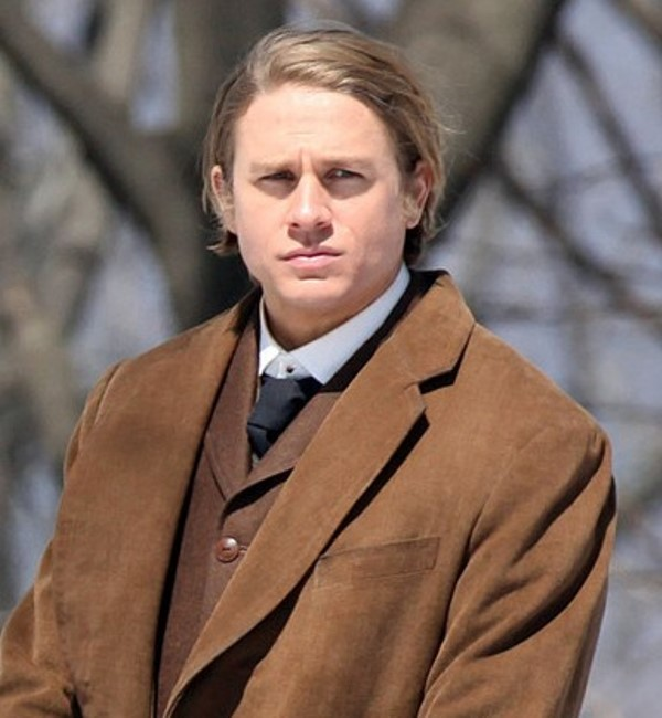 Charlie Hunnam, best known for his role as Jax in Sons of Anarchy, as Dr. Alan McMichael in Crimson Peak.