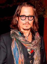 Johnny Depp wears only 2 scarves at David Furnishs 50th