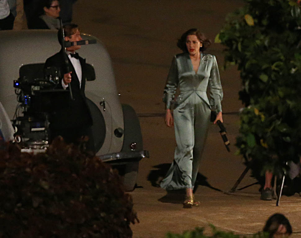 Brad Pitt and Marion Cotillard hold hands for a scene on
