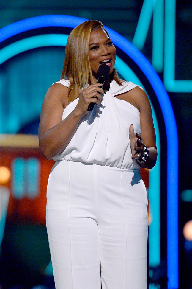 Queen Latifahs white jumpsuit at the MTV Movie Awards