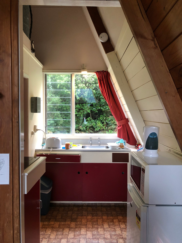 New Zealand South Island Tour - Makarora West. Inside the Kitchen of a Red A-Frame Cabin, Makarora, New Zealand
