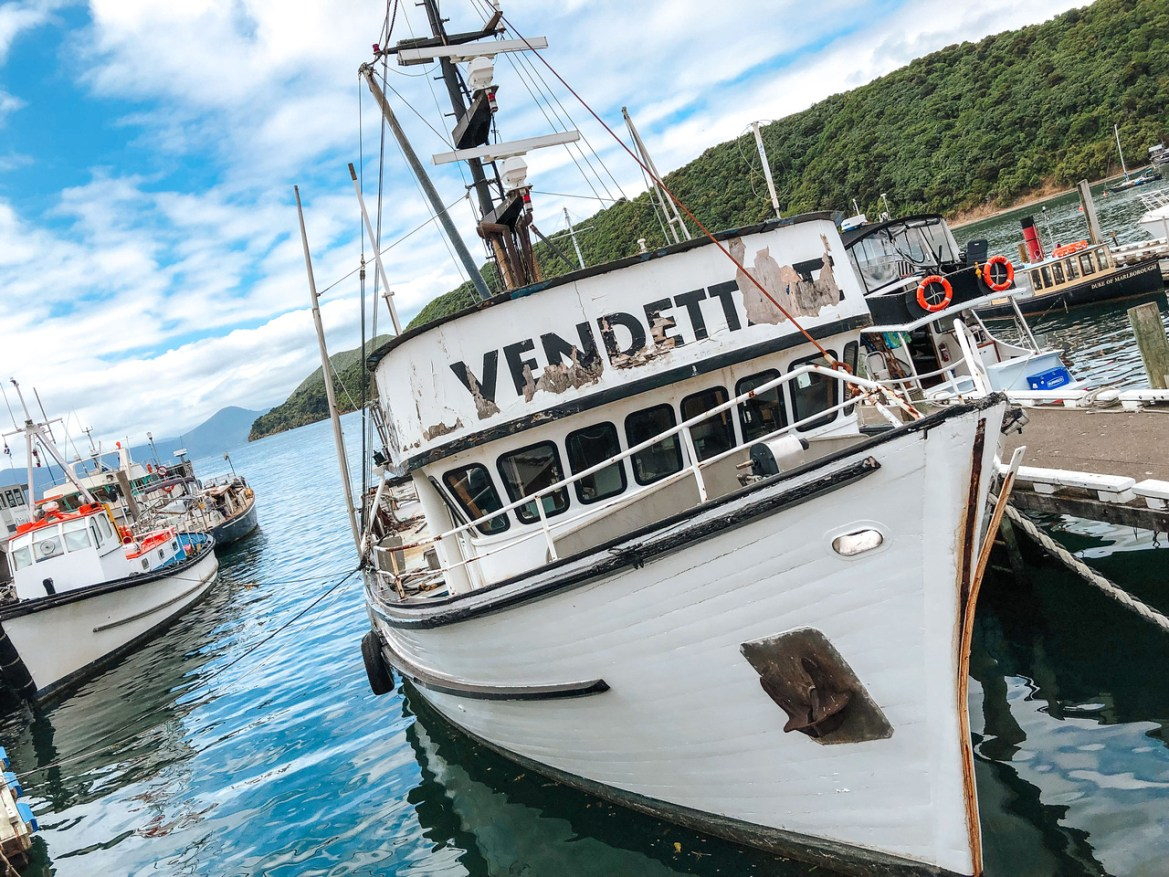 """New Zealand Cities: Picton New Zealand. A boat christened """"Vendetta"""" sits in the harbor at Picton, the South Island's departure and arrival port for inter-island travel between New Zealand's North and South Islands."""