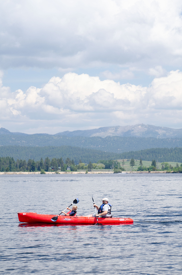 Lakes in Idaho: Lake Cascade State Park. A father and son kayak across Cascade Lake near Idaho's Cascade Lake State Park Poison Creek Campground near Tamarack Resort and Donnelly, Idaho.