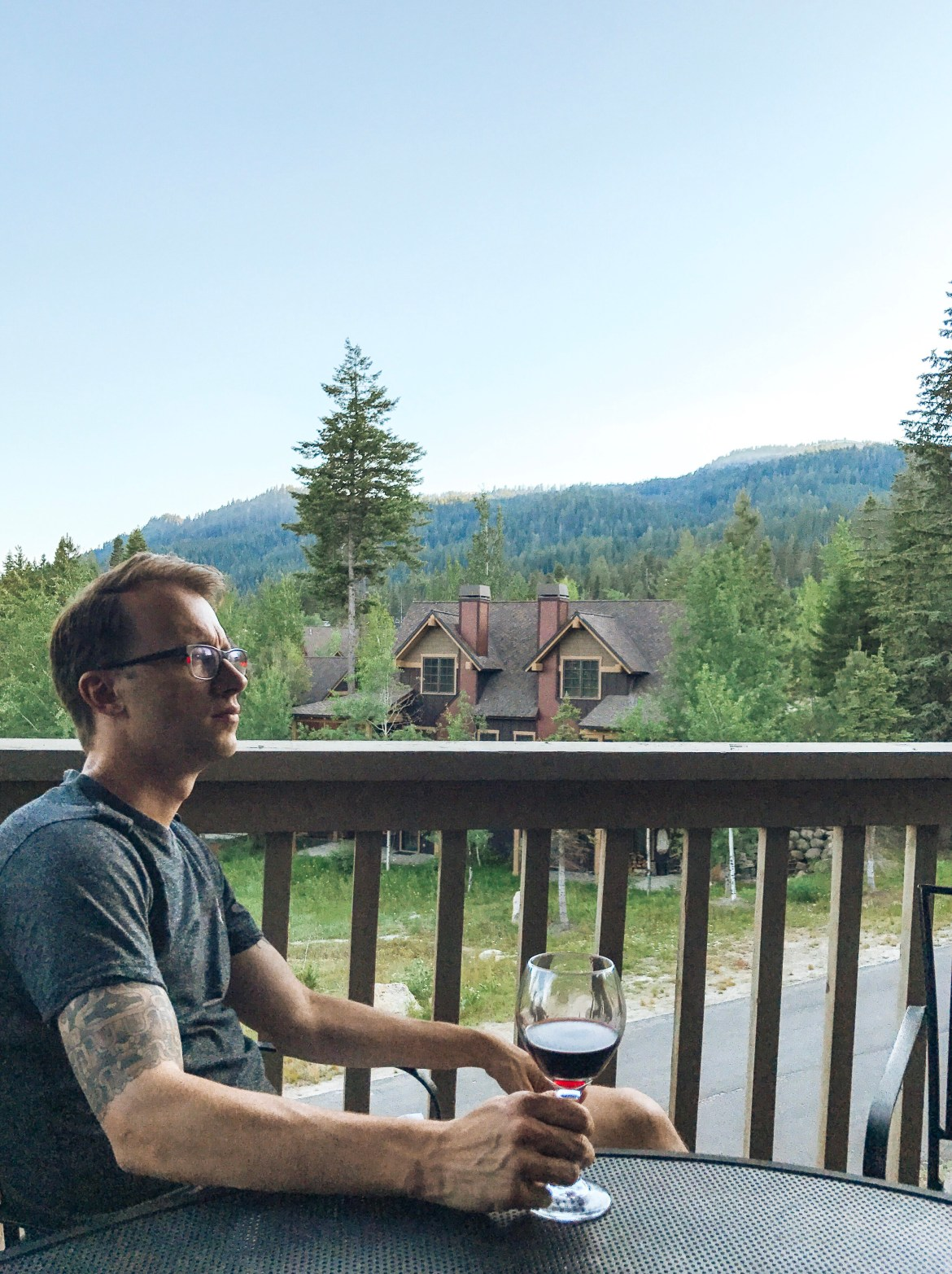 Idaho Resorts: Tamarack Resort.  Ben sits with a glass of Cabernet Savignon at a vacation rental cabin at Idaho's Tamarack Resort near Donnelly and Cascade off of Highway 55.  The resort has two rental options for cabins, homes, and other mountain accommodations.