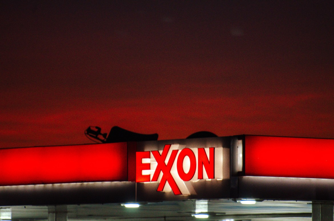 Day 1 of our recommended Yellowstone Vacation Itinerary: Yellowstone Road Trip.  The sun sets behind an Exxon Mobile gas station in St. Anthony, Idaho, near the highway leading North to West Yellowstone, Montana, and Yellowstone National Park.
