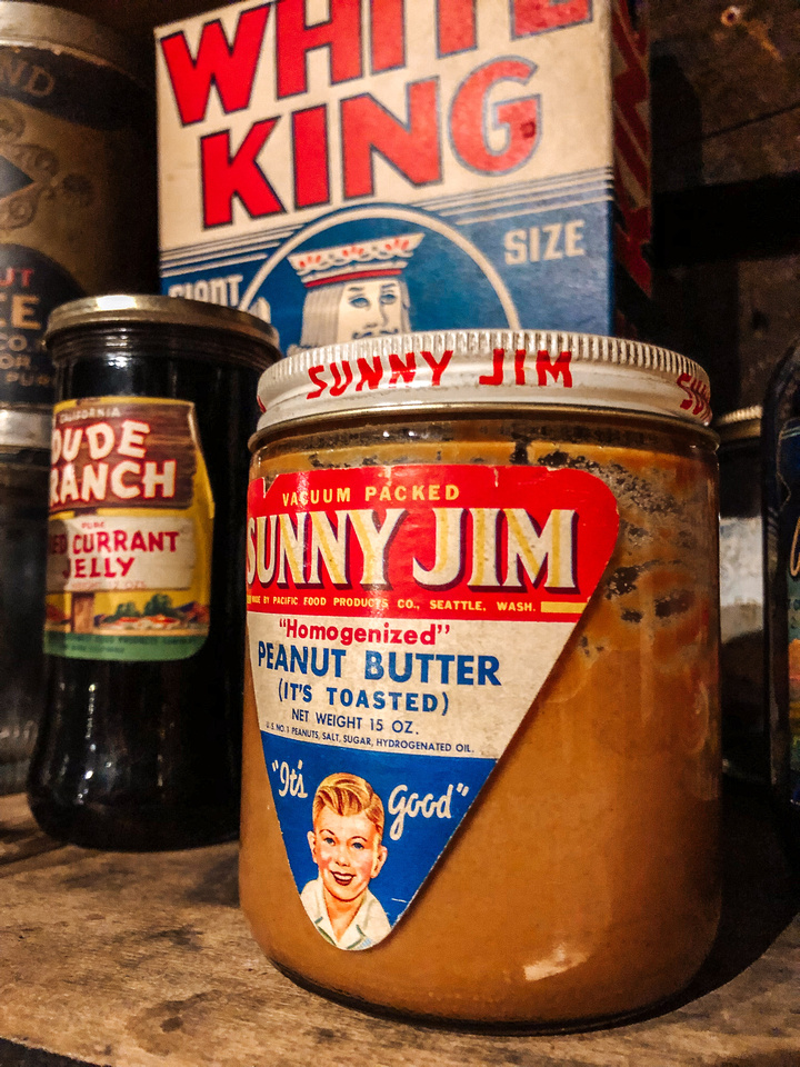 Interesting Oregon Facts: Jars of peanut butter and jam sit inside John Day, Oregon's Kam Wah Chung & Company, the most significant collection of 19th and 20th Century artifacts documenting Chinese immigrants in the American West.  Other packages and items for sale sit nearby in the Company's store.