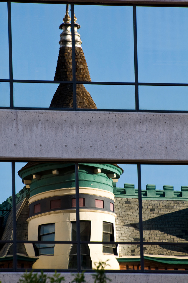 Victorian, Queen Anne, and French Château Architecture Stock Photos. The Boise, Idaho Idanha Building, an example of French Château Architecture, reflected in a contemporary cement and glass building.
