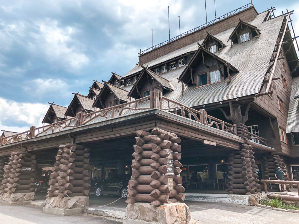 Hotel Photography: A view of the entrance to the Old Faithful Inn in Yellowstone National Park, Wyoming.  The iconic Lodgepole Pine lodge sits near Old Faithful and the Upper Geyser Basin near the Firehole River..