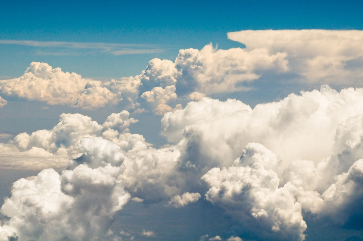Creative Photography - Free Cloud Background Images. Puffy white clouds billow and float above Northern Mexico.
