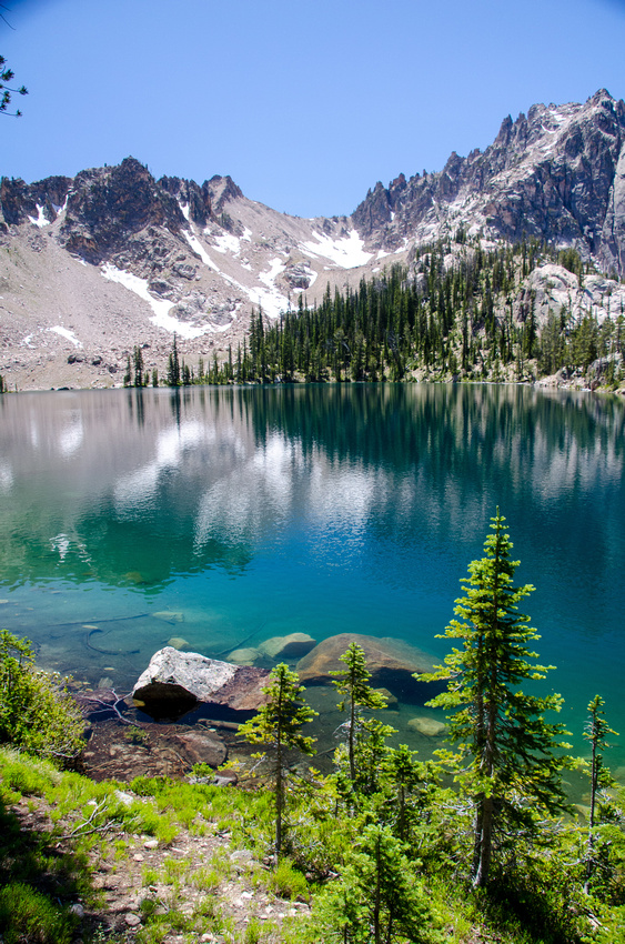 Best Baron Lakes Idaho Hikes - Grandjean Campground and Trailhead to Redfish Lake.  Scenic views of Upper Baron Lake, where deep alpine water turns various shades of green and turquoise.