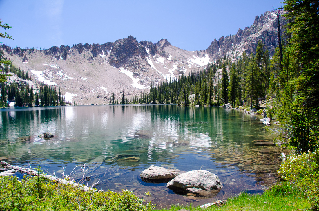 Best Baron Lakes Idaho Hikes - Grandjean Campground and Trailhead to Redfish Lake.  A view of Upper Baron Lake and surrounding peaks from the trail that leads to the saddle between Alpine and Upper Baron.