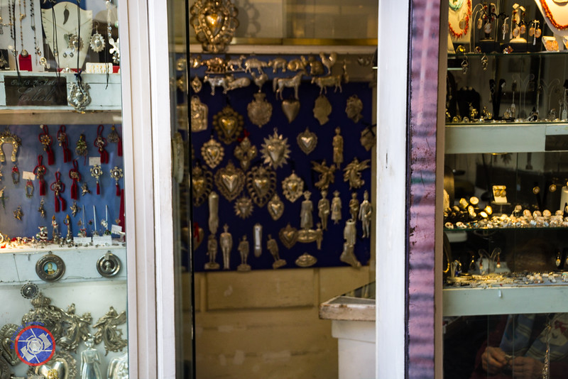A Store with a Display of Silver Ex-Votos for Sale (©simon@myeclecticimages.com)