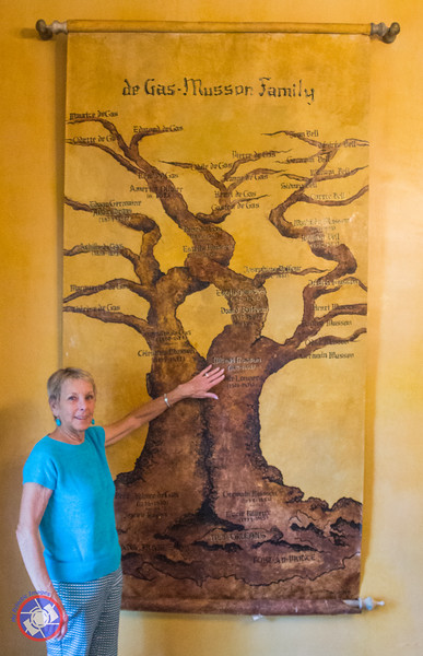 Micey Moyer Standing in Front of the Musson Family Tree Displayed in the Parlor of Degas House (©simon@myeclecticimages.com)