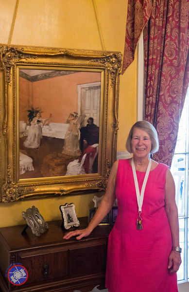 "Joanie Prados, a Great Grand Niece of Edgar Degas, with a Reproduction of ""Song Rehearsal"" Displayed in the Parlor of Degas House (©simon@myeclecticimages.com)"