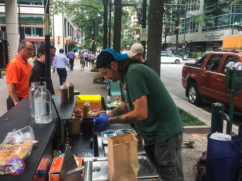 Vic the Chili Man Hard at Work Creating One of His Tasty Dogs (simon@myeclecticimages.com)