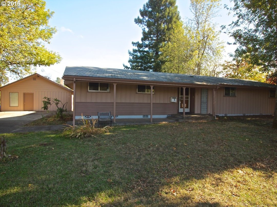 This  SW Eugene home has lots to offer. 1 level, a cozy fireplace in the living room w/ a slider to the deck off the dining area. 4 bedrooms & 2 bathrooms.  The huge fenced backyard has a lovely gazebo for entertaining. Lots of RV parking. A 2nd dwelling/shop, (sold as is), dividable lot as per city ( buyer to do due diligence for dwelling usage & requirements to divide.) View it today.