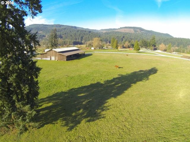 360-degree view of heavenly McKenzie Valley.  Ready for your dream home or two or three!  Two separate tax lots for total of 17.25 acres.  Gated, fenced, well and power in place.  Large barn suitable for any need.