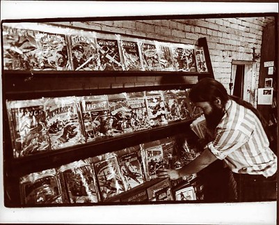 Photo courtesy Ken Sanders Ken Sanders organizes comic books at the 258 E. 100 South Cosmic Aeroplane location.