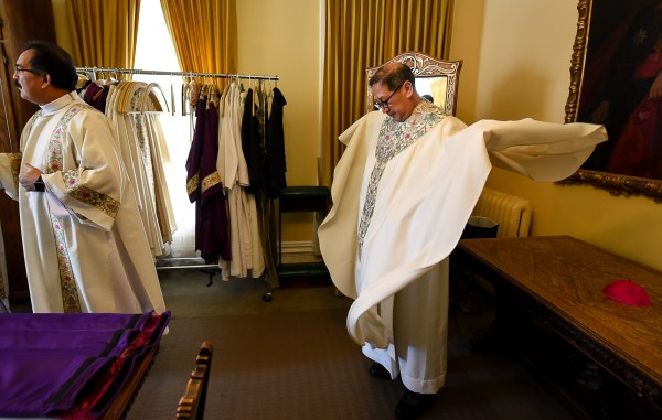 Francisco Kjolseth | The Salt Lake Tribune Bishop Oscar A. Solis and other priests vest in the Bishop Glass room moments before his installation as the 10th bishop of the Diocese of Salt Lake City.