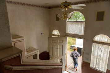 An FLDS boy runs out of a home as the UEP Trust evicts its residents in Colorado City, Ariz., Tuesday May 9, 2017.