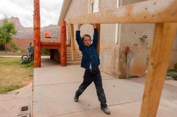 An FLDS boy helps move a table from a Colorado City, Ariz., home as his family is evicted, Tuesday May 9, 2017.