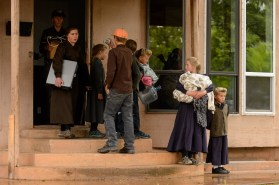 FLDS children take video and carry belongings as they are evicted from a Colorado City, Ariz., home by the UEP Trust after refusing to sign an occupancy agreement, Wednesday May 10, 2017.