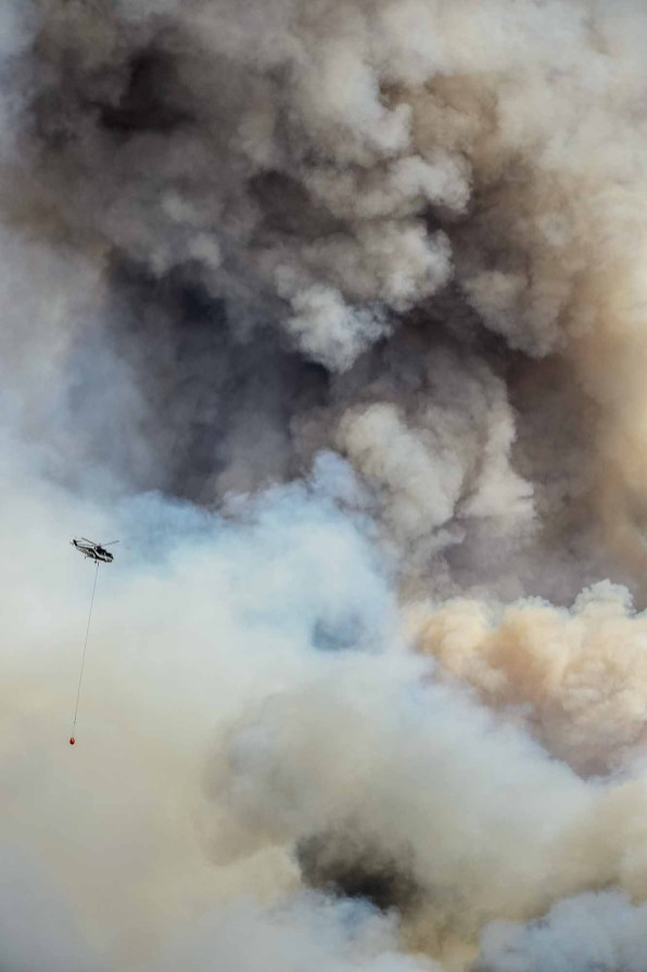 (Trent Nelson | The Salt Lake Tribune) Helicopters and tankers fight the Dollar Ridge Fire at Strawberry Reservoir on July 6.