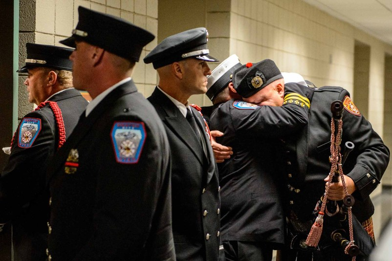 (Trent Nelson | The Salt Lake Tribune) Honor Guard at the funeral services for Draper Battalion Chief Matthew Burchett at the Maverik Center in West Valley City on Aug. 20. Burchett died during a deployment to fight the Mendocino Complex Fire in California when a tree fell on him.