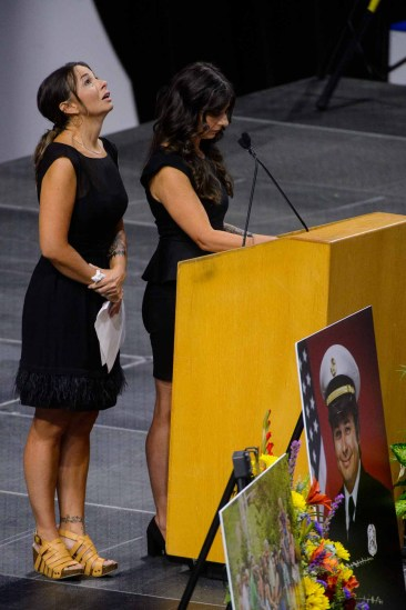 (Trent Nelson | The Salt Lake Tribune) Gina Zipp and Monica Brinkerhoff, sisters of Matthew Burchett, speak at his funeral service at the Maverik Center in West Valley City on Aug. 20. Burchett died during a deployment to fight the Mendocino Complex Fire in California when a tree fell on him.