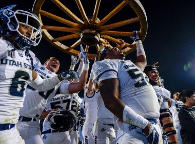 (Leah Hogsten | The Salt Lake Tribune) Utah State University Aggies celebrate their win after defeating Brigham Young University, 45-20, in Provo on Oct. 5.