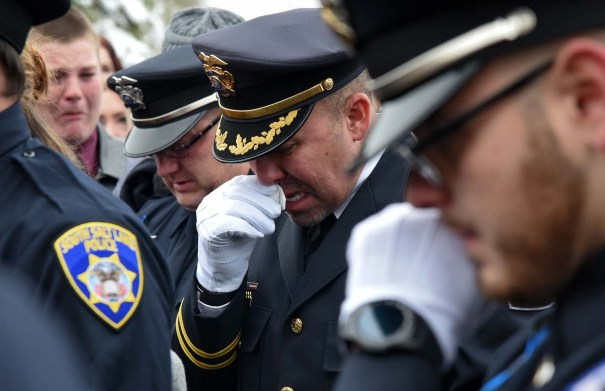 (Francisco Kjolseth | The Salt Lake Tribune) Hundreds of police officers attend funeral services for fellow officer David Romrell, who was killed after being struck by a car, at Larkin Sunset Gardens Cemetery in Sandy on Dec. 5.