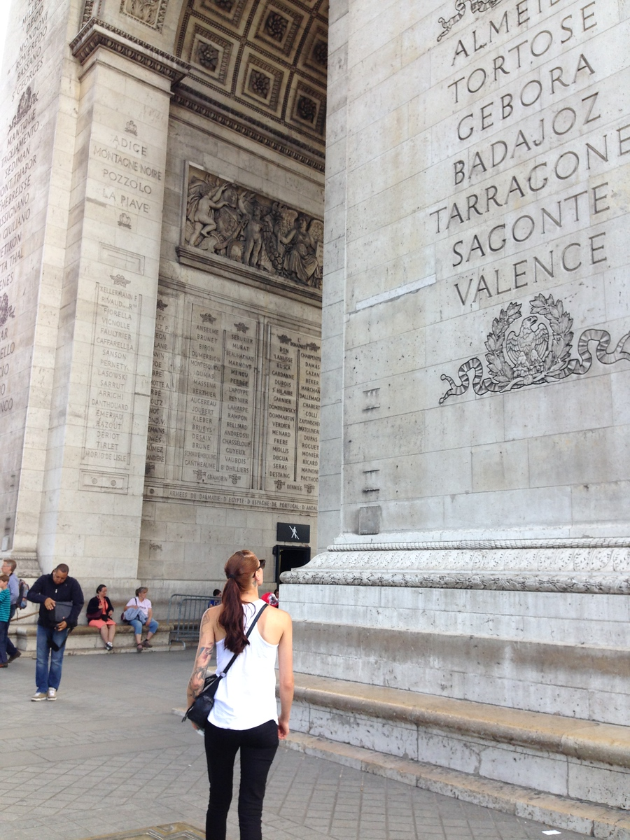 Jen Reading Names Etched into the Side of the Arc de Triomphe in Paris