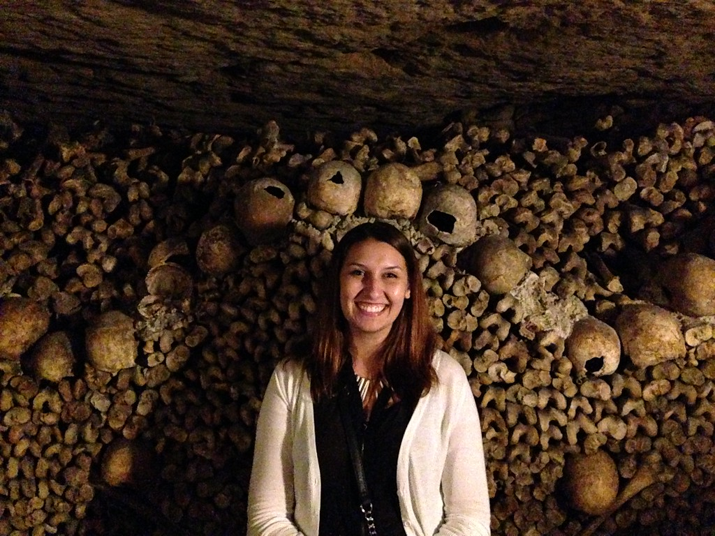 A Morbidly Cheerful Selfie With Some Skulls and Bones at the Catacombs of Paris, France