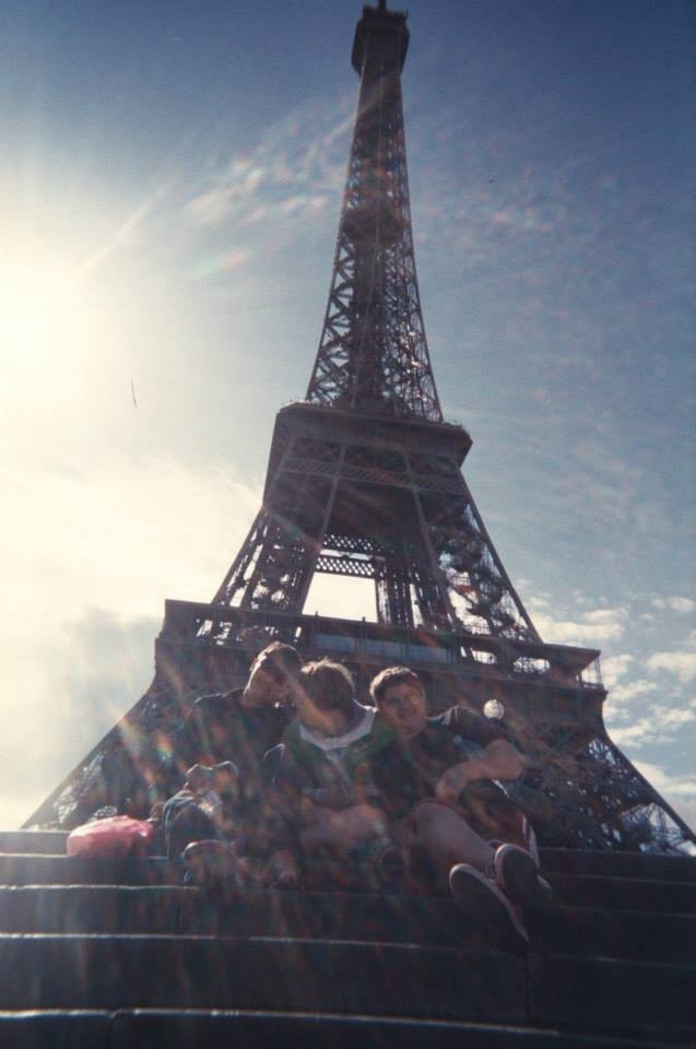 A Sun-Speckled Photo of my Younger Siblings Visiting the Eiffel Tower