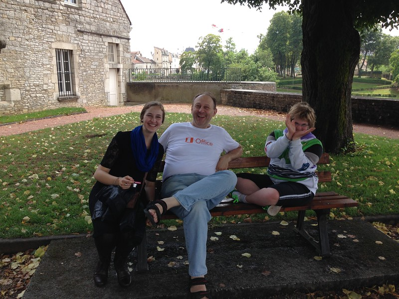 Family Relaxing on a Bench Overlooking Chaumont Centre-Ville, France