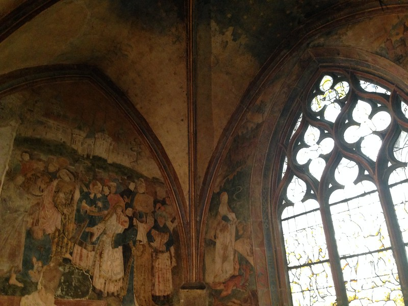 Worn Frecoes and Stained Glass in the Basilica Notre Dame of Beaune, France