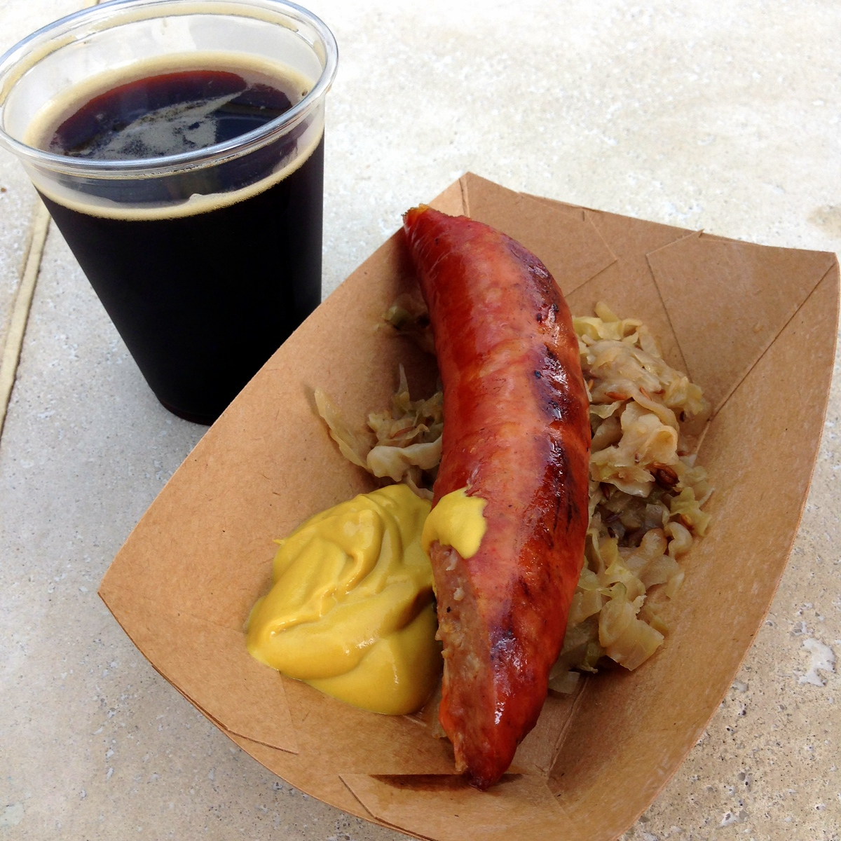 Maple Bacon Stout and Smoked Debreziner Sausage with sauerkraut and mustard from the Smokehouse Outdoor Kitchen at the 2015 Epcot International Flower and Garden Festival