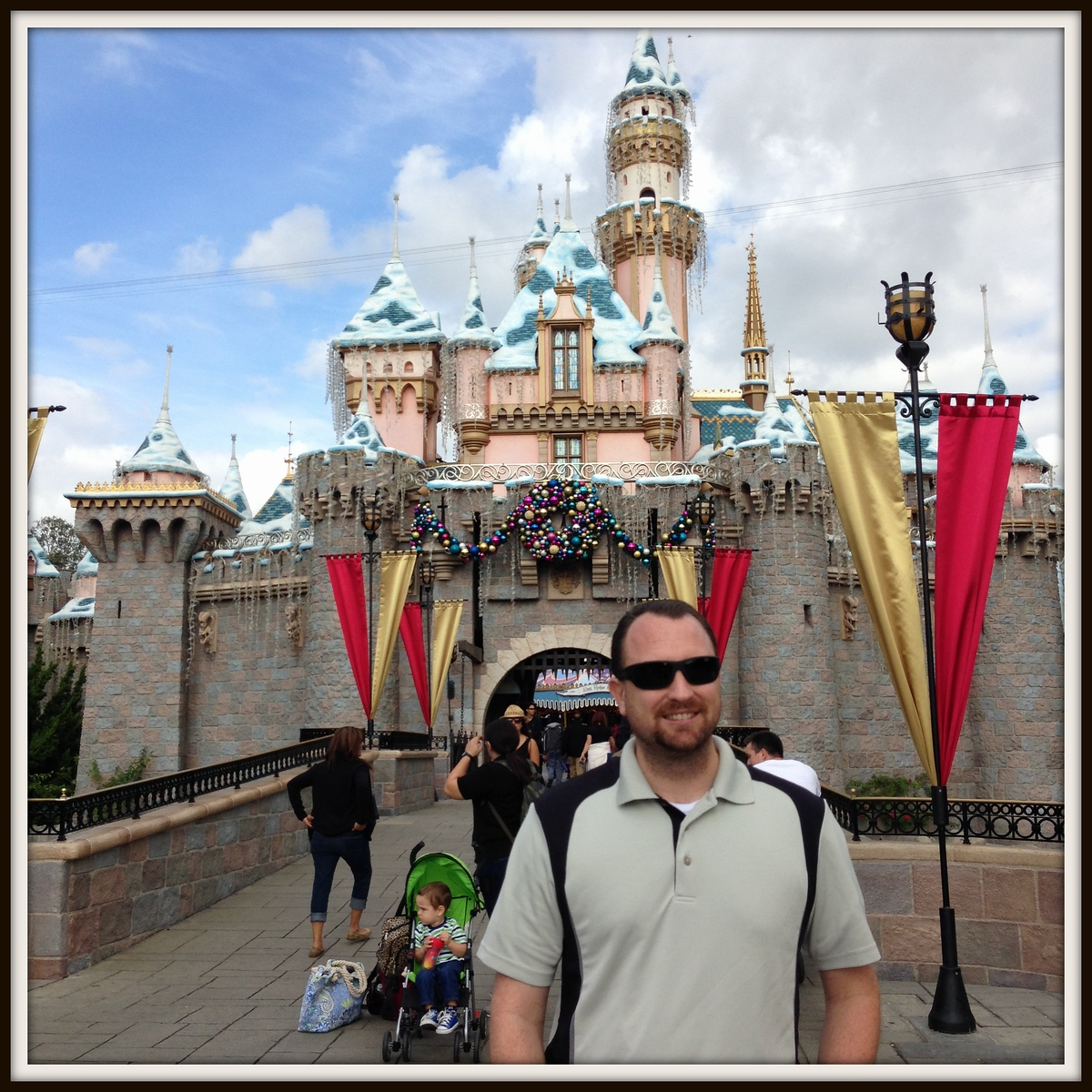 Dan in Front of a Snow-Capped Sleeping Beauty Castle at Disneyland in November 2014