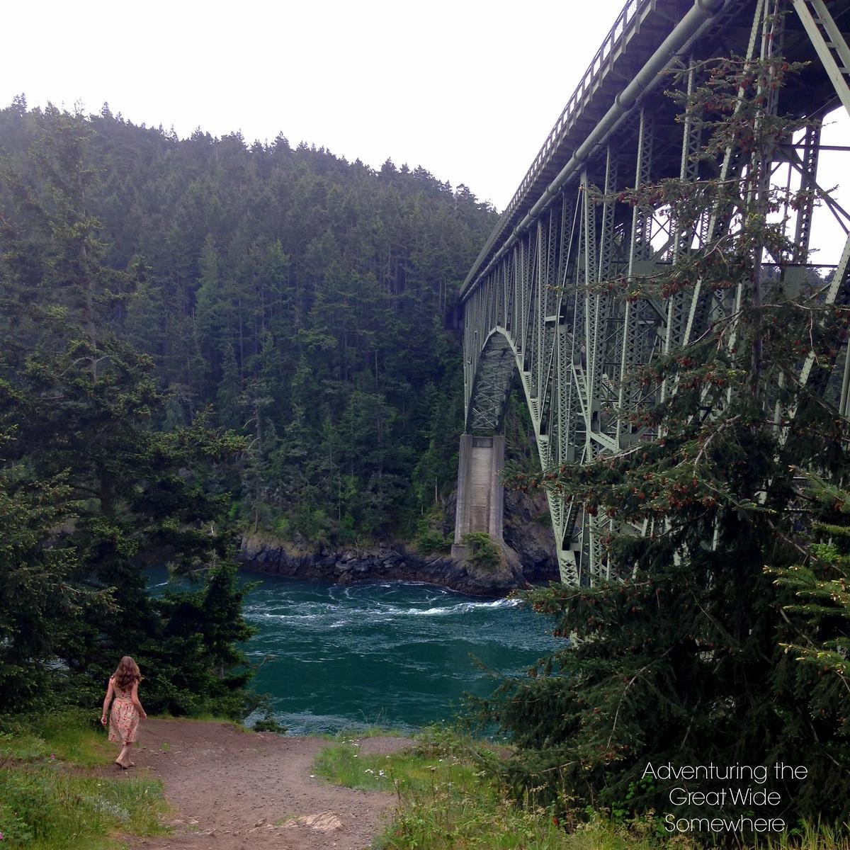 Michelle Exploring Beneath Deception Pass Bridge in Washington State