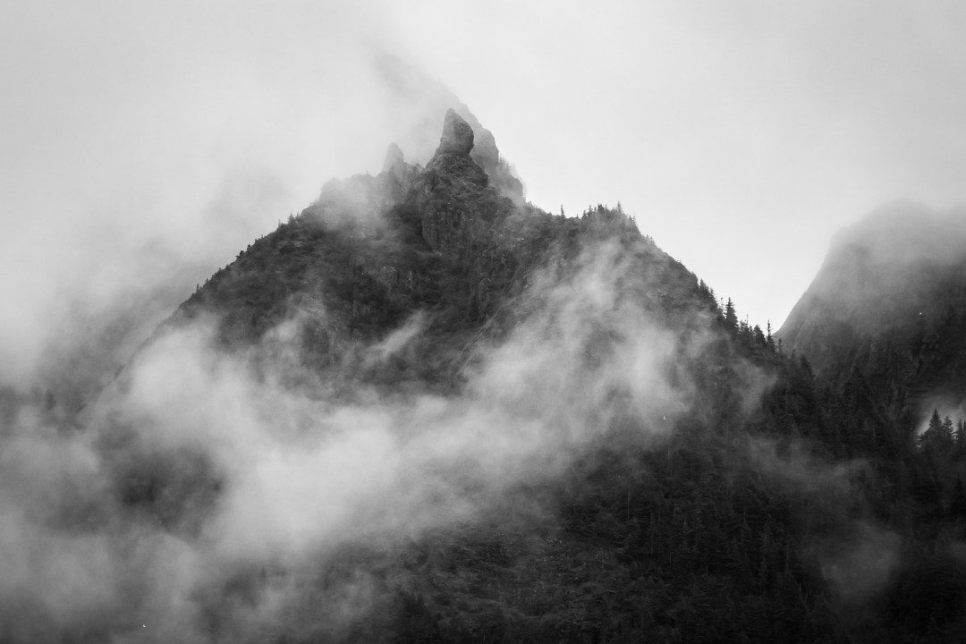 Fog and mountains in Resurrection bay during  a major marine tour of Kenai Fjords National Park out of seward, Alaska. Taken by Kimberly Kendall of Clicking with Kim