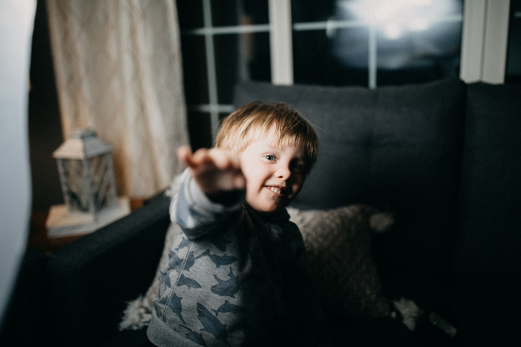 Small boy reaching out towards camera
